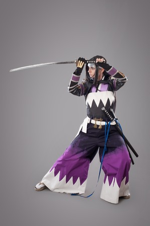 Japanese samurai with katana sword. Studio shoot. Isolated Stock Photo