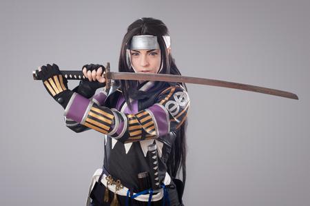 shogun: Japanese samurai with katana sword. Studio shoot. Isolated Stock Photo