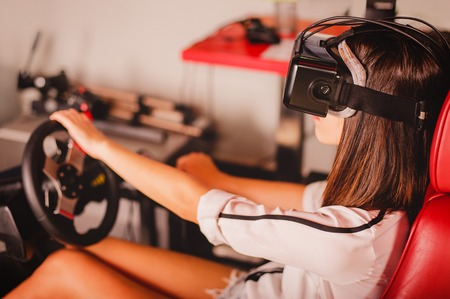 fissure: Woman play the video game with virtual reality device