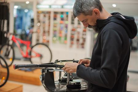 Stringing Machine. Tennis stringer doing racket stringing in his workshop Stock Photo