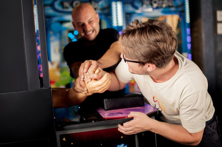 Two of friends having fun on the game room