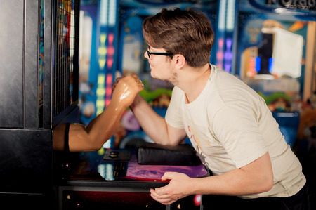 Young man playing games on the game room
