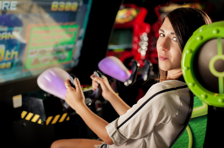 Young woman playing games on the game room