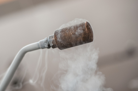 Smoking frozen pipe for liquid nitrogen. Close-up Stock Photo