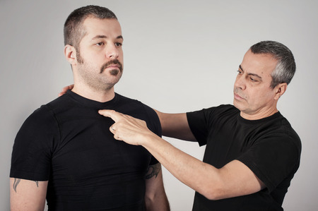 krav maga: Kapap instructor shows the critical and highly sensitive points on the human body. Pressure points fighting concept
