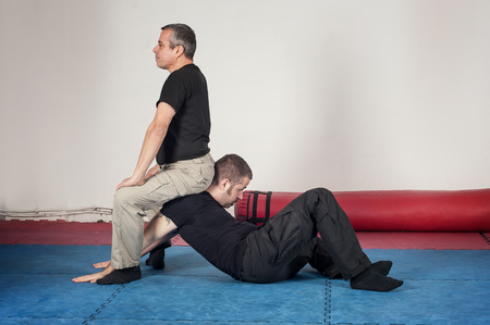 krav maga: Kapap instructor demonstrates arm lock techniques with his student