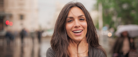 Happy cheerful smiling woman enjoy on the city streets. Panorama widescreen format