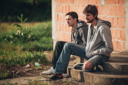 Two depressed and sad young buddies friends thinking together about their problems Reklamní fotografie