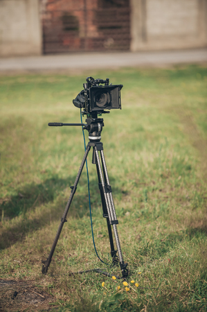 high definition television: Behind the scene. Film camera on outdoor location Stock Photo