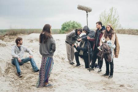 Behind the scene. Film crew team filming movie scene on outdoor location. Group cinema set Stock Photo