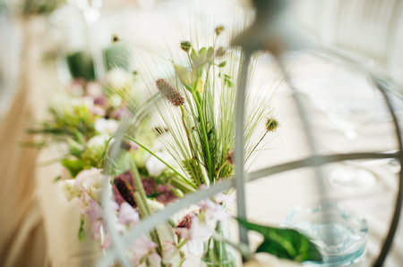 Wedding decorative floral flower bouquet arrangement on the table. Close up