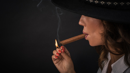 Portrait of sexy elegant lady woman with hat smoking cigar. Fashion glamour style. Studio shoot Reklamní fotografie