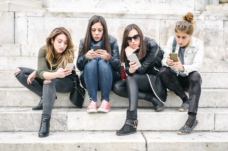 Group of girls with smartphones. Technology cell phone isolation and emotional depresion. Internet and social media