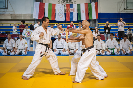 self testing: BELGRADE, SERBIA - 30. SEPTEMBER 2017. Instructor Demonstrate Breaking Technique. Evening of Martial Arts  Kyokushin Belgrade Trophy at Sumice Sport Center. KYOKUSHINKAI FEDERATION OF SERBIA