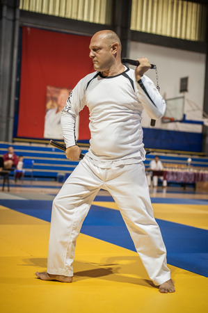 self testing: BELGRADE, SERBIA - 30. SEPTEMBER 2017. Instructor Demonstrate Nunchaku Techniques. Evening of Martial Arts  Kyokushin Belgrade Trophy at Sumice Sport Center. KYOKUSHINKAI FEDERATION OF SERBIA