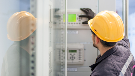 Engineer commissioning bay control unit. Engineering department. Medium voltage switchgear Standard-Bild