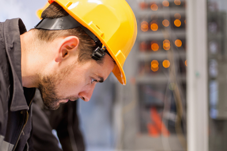 Engineer commissioning bay control unit. Engineering department. Medium voltage switchgear Stock Photo