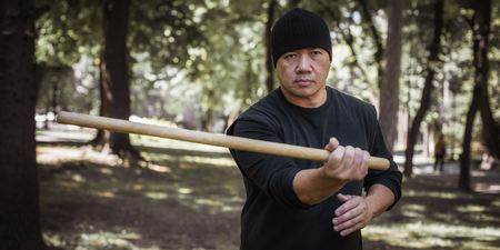 Lameco Astig Combatives instructor demonstrates single stick fighting techniques and training methods. Filipino Martial Arts. Ecrima, Kali, Arnis Фото со стока