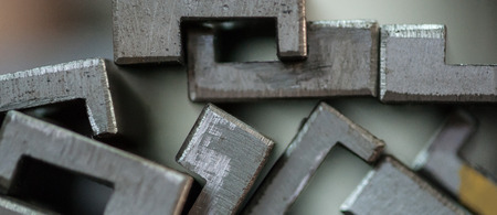Close up of stacked metal plates. Selective focus Imagens