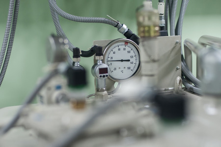 Close up of machine valve system measure indicator for monitoring condition