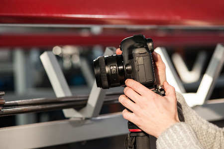 Man hand holding camera and take the photo. Selective focus Stock Photo