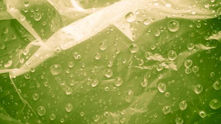 Abstract green water drops. Macro shooting background Фото со стока