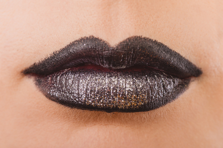 Close up of beautiful woman face portrait with tinsel makeup. Macro shooting photography