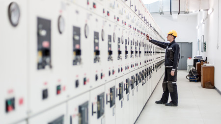 Engineer commissioning bay control unit. Engineering department. Medium voltage switchgear Stock Photo