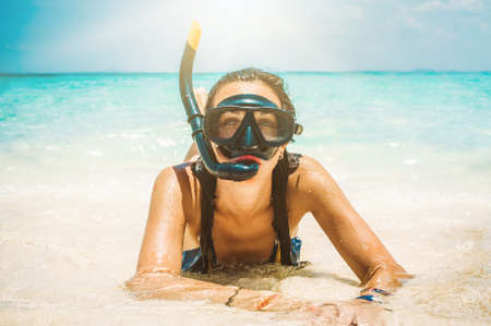 Happy young woman with snorkeling mask enjoying on the beach. Koh Hong, Thailand
