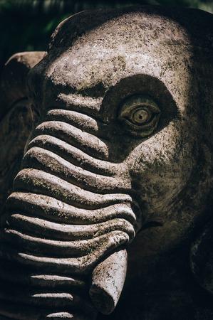 Closeup portrait of Hindu Buddhist traditional animal sculpture artform incorporated into temples. Bali, Indonesia