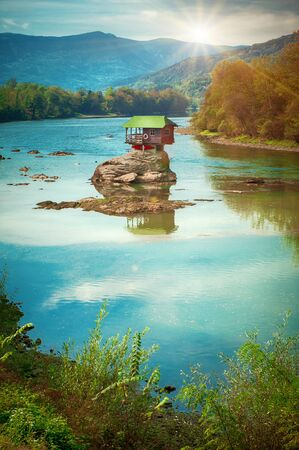 BAJNA BASTA, SERBIA - 20. OCTOBER 2018. Beautiful lonely house on the river Drina. Day editorial shot