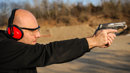 Target gun and pistol shoot practice and police and bodyguard weapons training. Outdoor shooting range