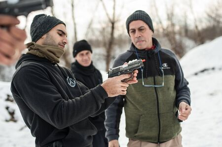 Pozarevac, Serbia - December 21-24, 2018: Kapap Instructor Avi Nardia teaches his students on the shooting range GROM, how to safely use the gun on KAPAP BASIC FIREARMS SAFETY AND GUN USE SEMINAR