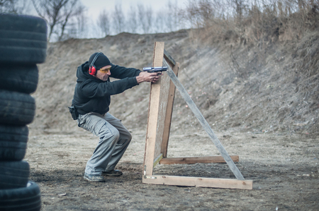 Combat gun shooting training from behind and around cover or barricade. Advanced fighting tactical shooting courses on shooting range