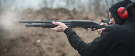Combat shotgun shooting training. Long gun, pump gun and scattergun action course. Shooting range Stock Photo