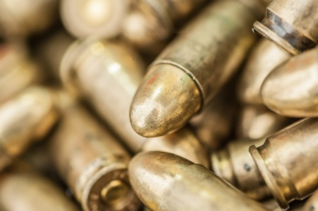 Top detail macro view of large group of gun bullets. Ammunition background