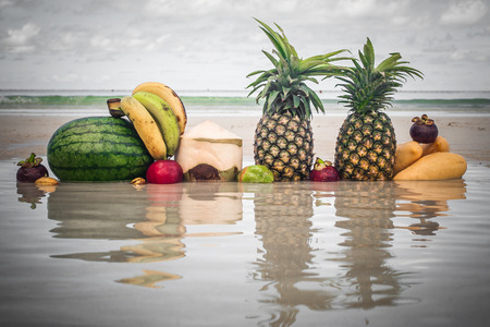 Closeup of exotic and colorful tropical fresh fruit on the beach. Summer healthy vitamin mix wallpaper