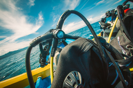 Scuba diving kit set on the boat, ready for dive. Diving equipment