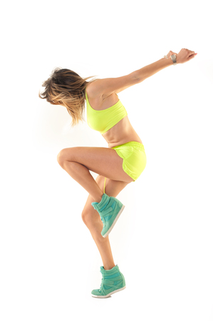 dance fitness instructor doing sport aerobic exercises. Motivational coach. Indoor training