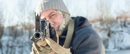 Kalashnikov rifle front view gun point. Direct macro detail close-up of machine gun. Outdoor shooting range
