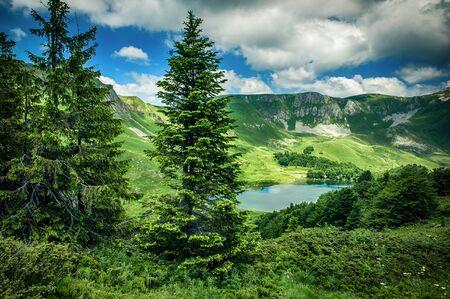 Panoramic view of beautiful mountain range with crystal clear turquoise lake. Pesica lake, Bjelasica, Montenegro