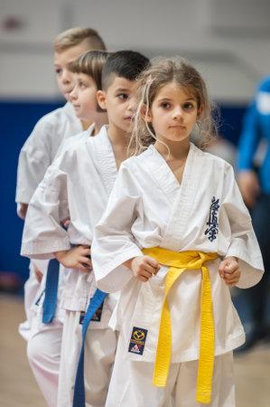 BELGRADE, SERBIA - 28. SEPTEMBER 2019. Cute little girl in kimono on Martial Arts Sport Demonstration. Evening of Martial Arts / Kyokushin Belgrade Trophy at Sport Center RADIVOJE KORAC
