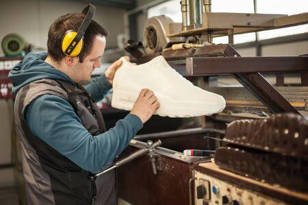 Worker technician make object on 3D sublimation vacuum heat press machine in digital printshop office