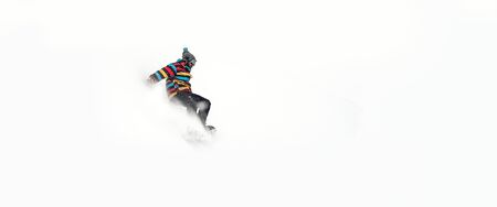Freerider snowboarder rolls and rides his snowboard on extreme gradient downhill. Winter mountain freeride. Space place for text