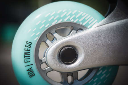 Close up of inline roller skates with blue wheels. Extreme sport. Concept about sport and leisure. Sport lifestyle. Fun time activity Imagens