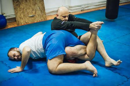 BJJ Brazilian jiu-jitsu ground fight training combat sparing. Leg lock calf slicer submission control technique