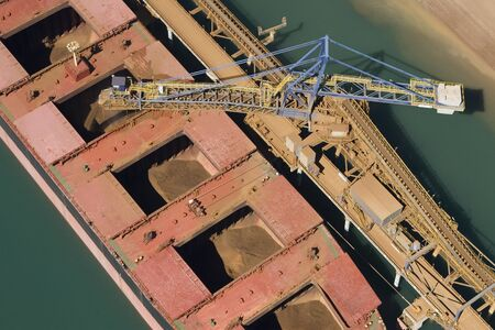 Iron ore ship being filled from top view. 스톡 콘텐츠