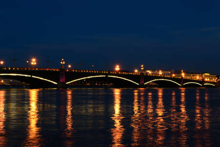 neva: Trinity bridge over the Neva River at night
