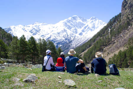 top seven: a group of people looking at the mountain, view from the back