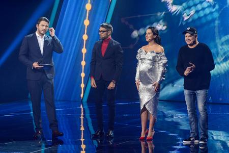 KYIV, UKRAINE - FEBRUARY 10, 2018: Jamala (2R), Andriy Danylko (1R), Eugene Filatov (2L) - members of the jury of the national selection Eurovision-2018 from Ukraine